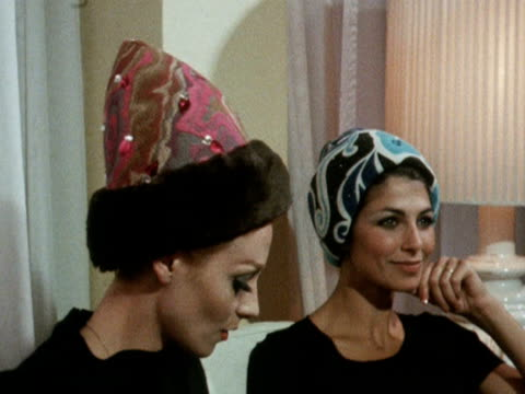 two models wear conical style patterned hats 1968 - strohhut stock-videos und b-roll-filmmaterial