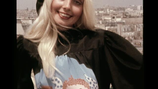 vídeos de stock, filmes e b-roll de two models wear cupid silk smock dresses designed by feraud - cupido