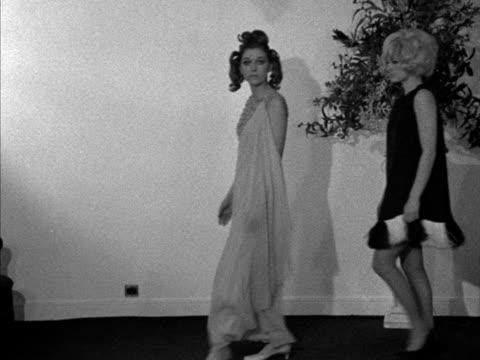 vídeos y material grabado en eventos de stock de two models wear long and short evening dresses designed by paterson. - vestimenta para mujer
