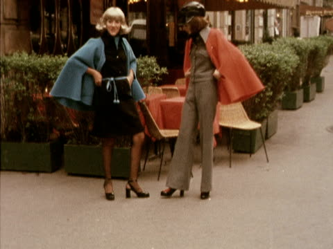 two models wear red and blue woollen capes designed by torrente 1972 - wool stock videos & royalty-free footage
