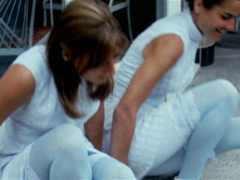 two models wear white tennis dresses with lace trimmed bloomers designed by teddy tinling june 1969 - knickers stock videos & royalty-free footage