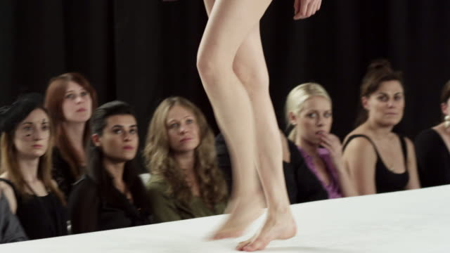 two models wearing swimsuits on catwalk at fashion show - runway stock videos and b-roll footage