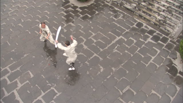 two monks practice martial arts at shaolin temple. - martial arts stock videos & royalty-free footage