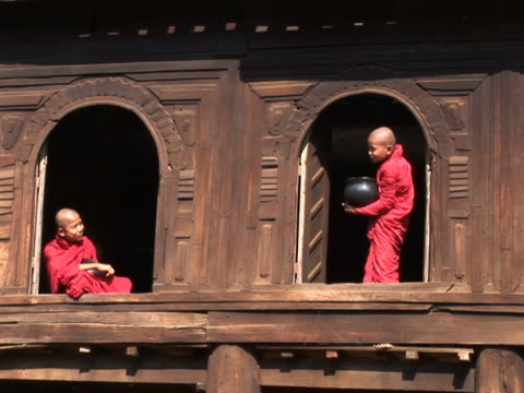 two monks standing in windows pal179 - myanmar stock videos and b-roll footage
