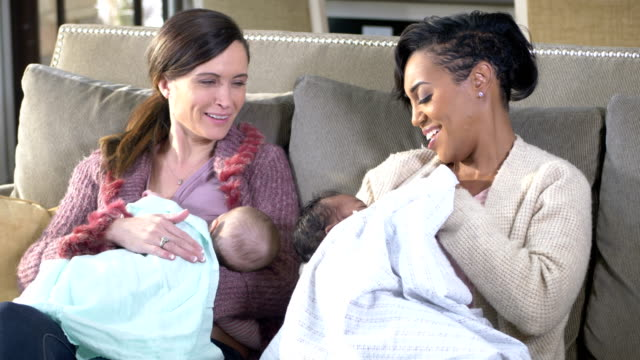 two mothers and babies, breastfeeding - breastfeeding stock videos & royalty-free footage