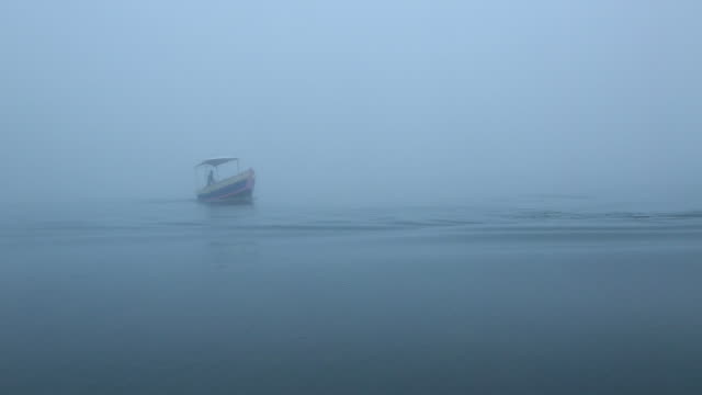 two motorboats cross in water - wiese stock videos & royalty-free footage
