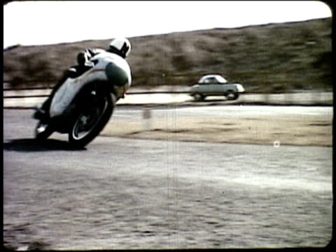 1963 MONTAGE Two motorcyclists racing; Motorcycles coming off assembly line / Japan