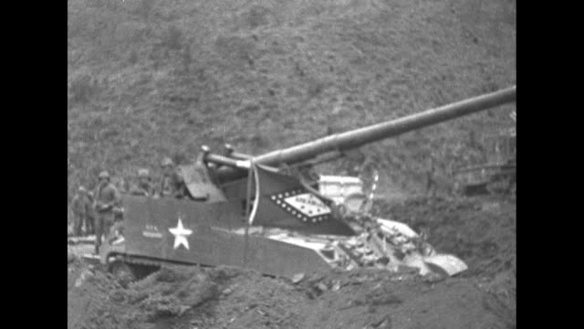two motorized us artillery pieces parked at bottom of ridge with soldiers manning them during korean war / closer view of one of artillery pieces /... - confederate flag stock videos and b-roll footage