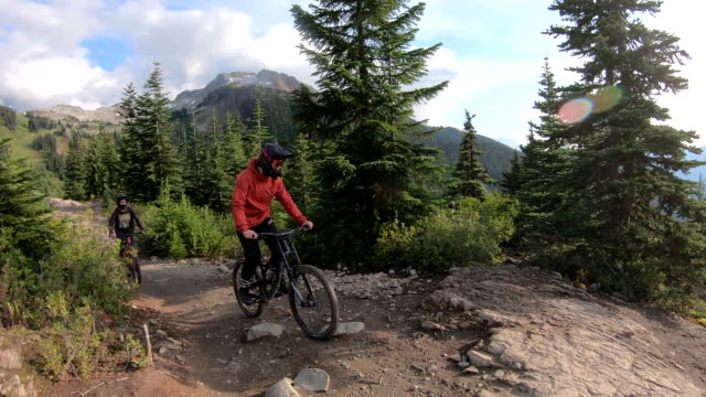 two mountain bikers traverse rock slab trail - mountain bike video stock e b–roll