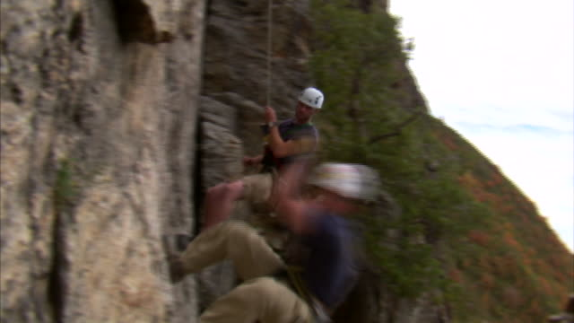 ms pan two mountain climbers jumping over camera / provo, utah, usa - provo stock videos & royalty-free footage
