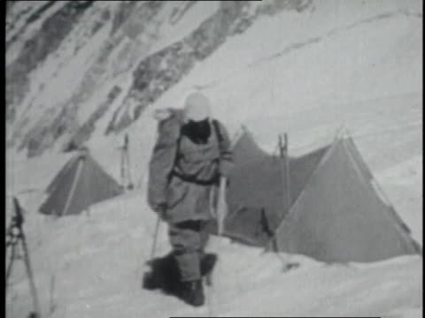 two mountaineers, tied together, climbing mount everest with hiking sticks / nepal - tenzing norgay stock videos & royalty-free footage