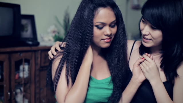 two multi ethnic asian young women in love. - crimped hair stock videos and b-roll footage