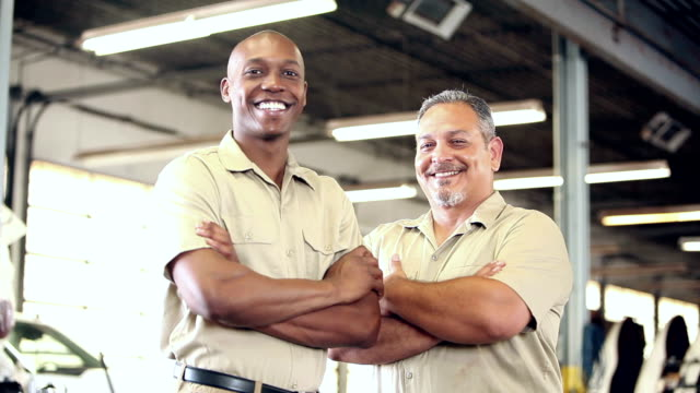 Two multi-ethnic workers in trucking industry