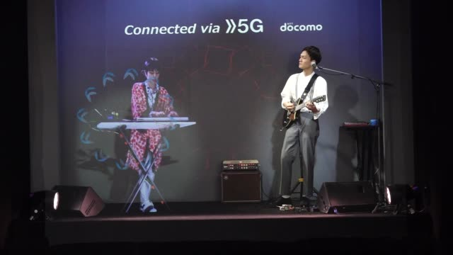 two musicians at the mobile world congress played on the same stage, but one was a hologram from another country via 5g, in barcelona, spain, on... - hologram stock videos & royalty-free footage