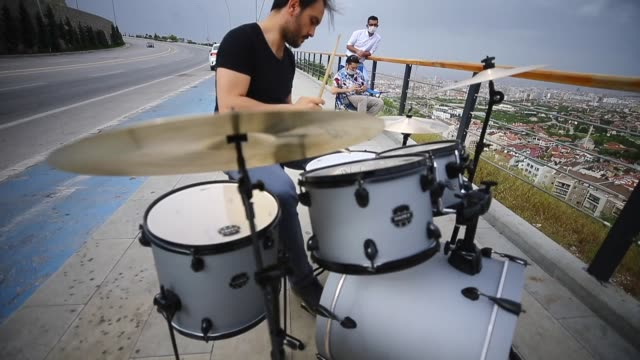 two musicians offer roadside music feast to fulfill longing their desire to play drums that they have been away from for 3 months due to coronavirus... - desire stock videos & royalty-free footage