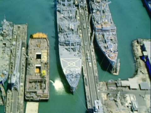 aerial two naval ships docked in the naval yard / san pedro, california, united states - 1960 stock videos & royalty-free footage