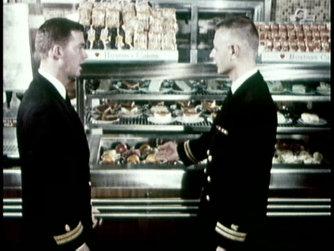 1966 MS two navy officers inspecting food available in the cafeteria / United States