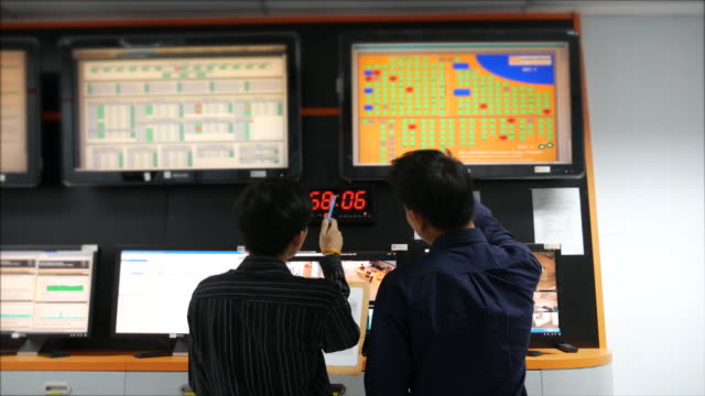 Two network engineer  working on System control room monitoring