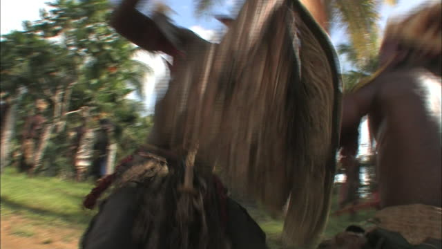 two new guinea warriors fight in a field. - ceremony stock videos & royalty-free footage