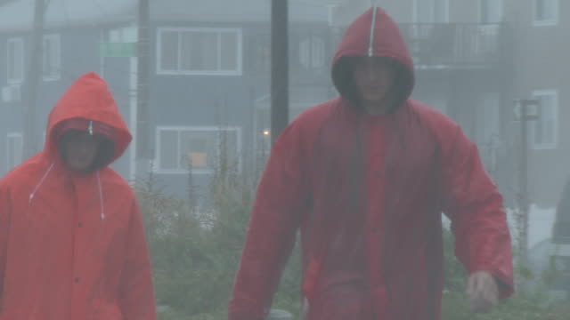 two new york city lifeguards are caught in a torrential downpour during a sudden summer thunderstorm on rockaway beach queens new york new york - scott mcpartland stock videos & royalty-free footage