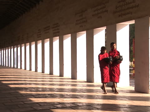 two novice monks walking down the hallway pal177 - myanmar stock videos and b-roll footage
