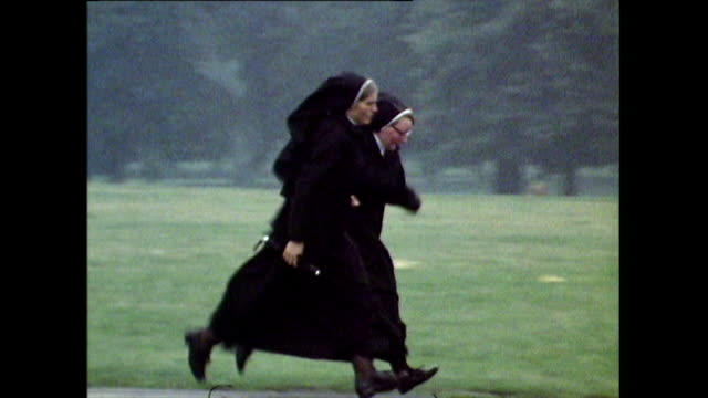 two nuns in black habits running because they're late; 1971 - nun stock videos & royalty-free footage