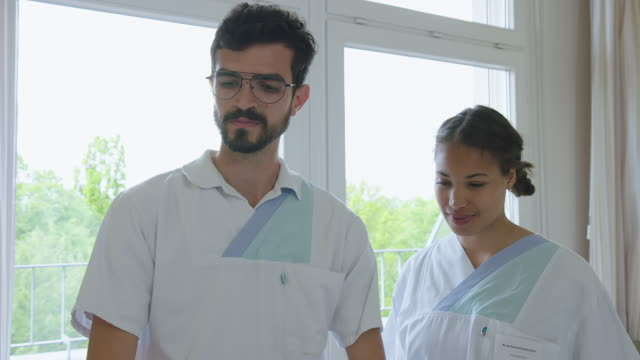 two nurse in hospital ward - colleague stock videos & royalty-free footage