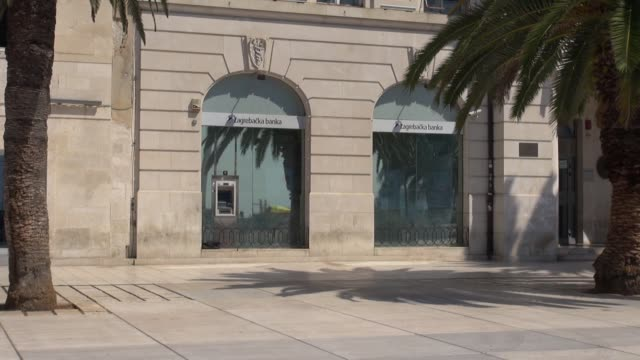 two of the biggest bank branches in split, croatia share the building with the british and italian consulates. banks at the consulate building,... - größter stock-videos und b-roll-filmmaterial