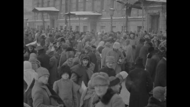 two overhead shots of crowd milling about amongst booths people in winter clothing soldiers interspersed / two ground level shots of crowd milling... - onion dome stock videos and b-roll footage