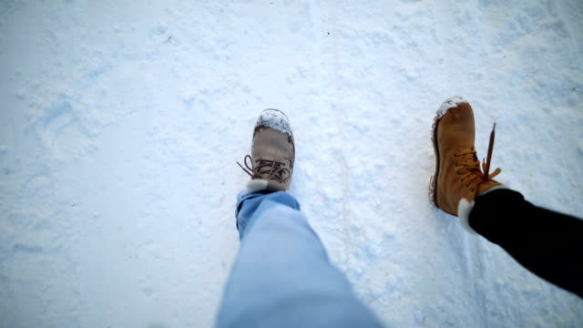 two pairs of boots hiking on the snow - boot stock videos & royalty-free footage