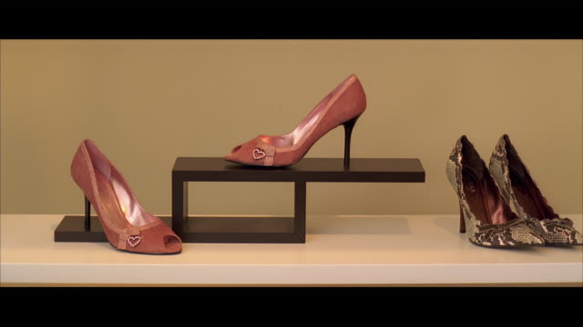MS Two pairs of high heel shoes on display