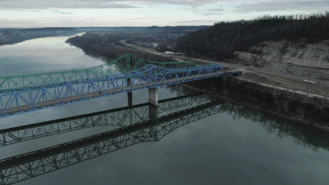 two parallel automobile bridges in ashland over ohio river from kentucky to ohio, usa. aerial drone video with the forward camera motion. - virginia us state stock videos & royalty-free footage