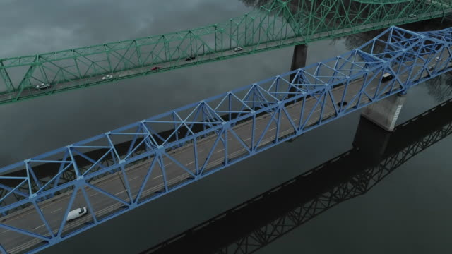 two parallel automobile bridges in ashland over ohio river from kentucky to ohio, usa. aerial drone video with the forward camera motion. - west virginia us state stock videos & royalty-free footage