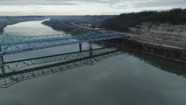 two parallel automobile bridges in ashland over ohio river from kentucky to ohio, usa. aerial drone video with the forward camera motion. - kentucky stock videos & royalty-free footage