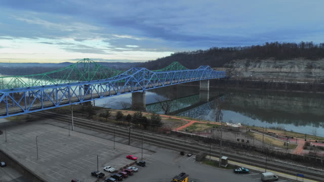 two parallel automobile bridges in ashland over ohio river from kentucky to ohio, usa. aerial drone video with the forward camera motion. - industrial district stock videos & royalty-free footage