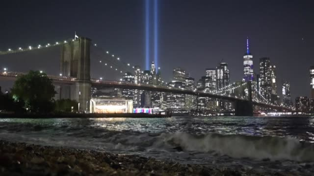 two parallel light beams illuminate the manhattan skyline 18 years after the 9/11 attacks - parallelo video stock e b–roll