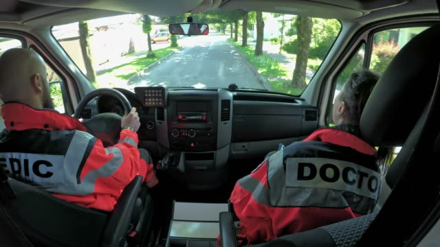 ld two paramedics driving in an ambulance - paramedic stock videos & royalty-free footage