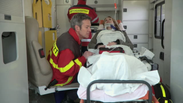 MS, Two paramedics with female patient in ambulance, Berlin, Germany
