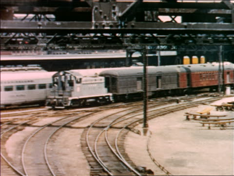1954 two passenger trains moving slowly in train yard / industrial - shunting yard stock videos and b-roll footage