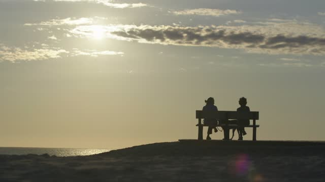 two people chat during the sunrise on the beach on september 26, 2021 on assateague island, maryland. there have been 10,166 deaths from covid-19 in... - atmosphere filter stock videos & royalty-free footage