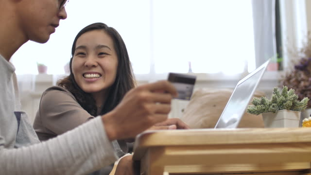 Two people Credit card online shopping on Laptop at Home