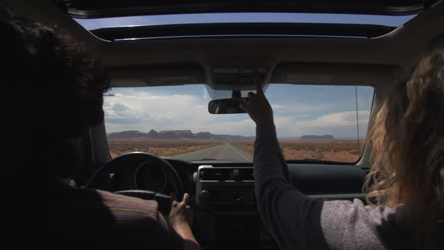 two people driving through the desert - passenger seat stock videos & royalty-free footage