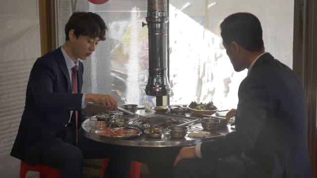 two people eating korean barbecue - korean culture stock videos & royalty-free footage