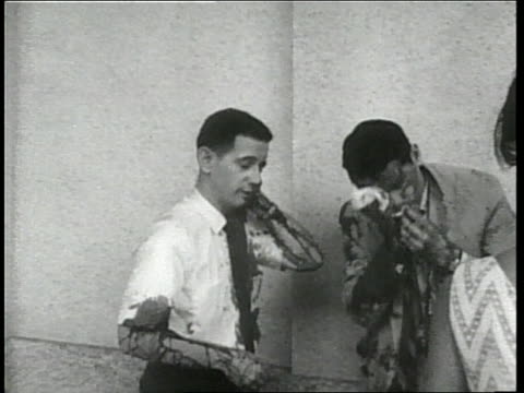 two people from the united states and twenty people from vietnam die when a bomb explodes in front of the u.s. embassy in saigon. - 南ベトナム点の映像素材/bロール