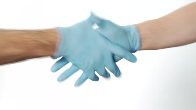 cu, two people in surgical gloves shaking hands, close-up of hands - glove stock videos and b-roll footage