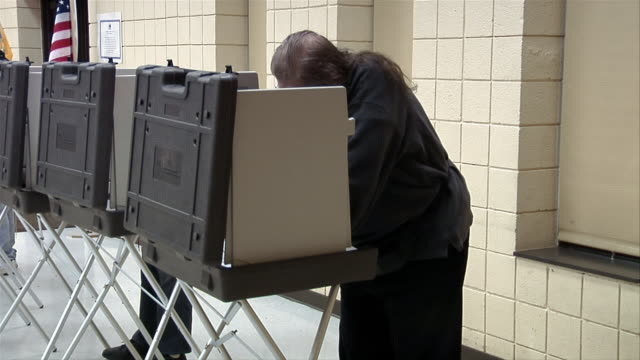 ms, two people in voting booths, ypsilanti, michigan, usa - ypsilanti stock videos & royalty-free footage