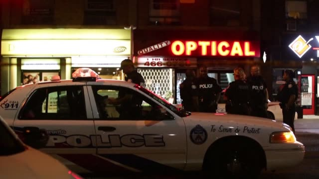 two people including the gunman are dead and 13 wounded in toronto after a shooting sunday in the busy greektown neighborhood adding to concern about... - toronto stock videos & royalty-free footage