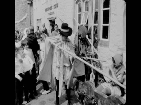 two people jokingly being tormented in stocks during a medieval fair in chardstock, devon; 1971 - laughing stock videos & royalty-free footage