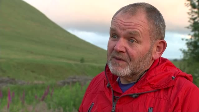 two people killed in lightning strikes in brecon beacons wales brecon beacons ext dave coombs interview sot two people got to corn du to see people... - ブレコンビーコンズ国立公園点の映像素材/bロール
