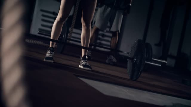 two people lifting weights in a gym - strongwoman stock videos & royalty-free footage